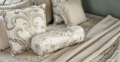 Kobe -  Nomad Fabric Collection - Luxurious cream and champagne coloured patterned and plain fabrics making up bedding, scatter cushions and a bolster cushion
