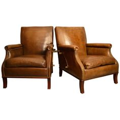 Pair of French Leather Reclining Armchairs | From a unique collection of antique…