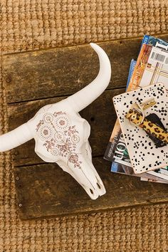 The Ram Skull is crafted from poly resin and has a metal hook on the back so it can be easily hung on your wall. <br> Use it to hang your favourite accessories and decorate you're space! <br> There are multiple designs to choose from! <br> Dimensions: 30cmW x 25cmL <br> Composition: 100% Poly Resin <br/>