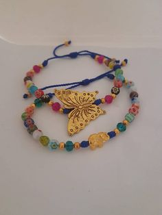 Butterfly and Elephant Bracelets, 2 Bracelets Cord, Millefiori Beads Bracelets, Butterfly Bracelets, Elephant Bracelets, Blue Cord Bracelets #giftidea #etsyshop #millefiorijewelry #cordbracelets #takkaibykarina #bijoux2018 #bracelet #handmadejewelry #butterfly #elephantjewelry #summerjewelry #