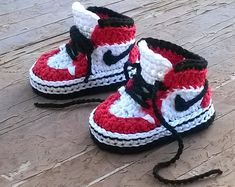oOo___ Instant Download Pattern___oOo  This listing is for a PDF crochet pattern only and not the finished ítem.  You will receive elaborated written PDF in ENGLISH and SPANISH for crocheting this original baby sneakers which remind us the popular and mythical 1985 Air Jordans sneakers. This pattern is written in American terminology.  It is a step by step tutorial with more than 50 photos and clear instructions to make it easier. Skill level: Intermediate/Advance  Size: 0-3 months(appro...