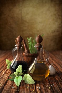 Italian style    Bottle of olive oil and vinegar, garlic and herbs