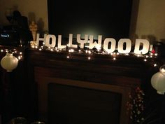 """I like this, but instead """"WELCOME TO THE OSCARS."""" HUNG ABOVE THE STAGE.  (lights)"""