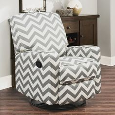 A large scale chevron pattern adds a quirky touch to the luxurious comfort of the Bella Swivel Glider Recliner from Abbyson Living. Generously padded all over, it offers a sinous spring suspension back rest and 2 recline positions (TV and full). Swivel Rocker Recliner Chair, Swivel Glider, Small Table And Chairs, Black Dining Room Chairs, Living Room Chairs, Blue Chairs, Desk Chairs, Office Chairs
