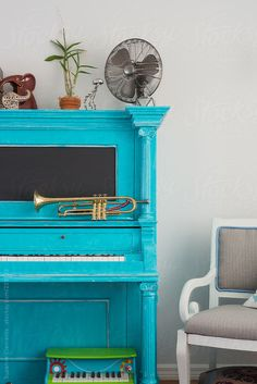 Teal Piano and Trumpet Living Room by Suzanne Clements