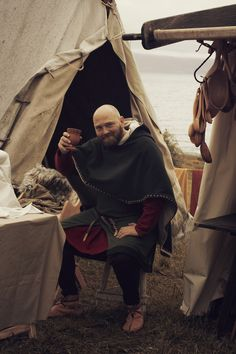 Cheerful reenactor. Trondheim Viking Market. Photo by Julie Brauteset Henning- I love the hood/cloak