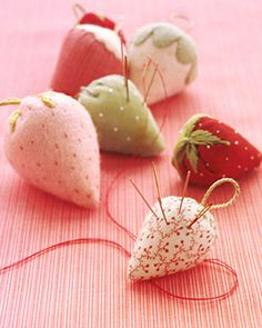 You may remember seeing charming strawberry pincushions like these in your grandmother's sewing box. Hers were probably sewn from scraps of leftover fabric; ours are made with ribbon remnants, shirting fabric, and felt, which works especially well because its edges won't fray.
