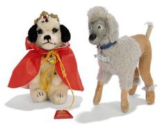 A STEIFF EXCLUSIVE FOR F.A.O. SCHWARZ ROYAL DALMATION DALLY, (4314,90), begging, black and white mohair, red cloack, metal crown, chest tag and F.A.O. Schwarz wooden tag, 1963 --5¾in. (14.5cm.) high; and Walther Poodle, (7517), standing, grey rubber face, wool plush and velvet, blue collar with Walther metal tag and script button, 1955 --7in. (17.5cm.) high (some discolouration) 	 (2)