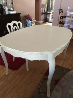 I found this queen lovely Ann table with 3 queen Ann chairs on Craig's list. painted using Annie Sloan old white and re-upholstered using a French print from Hobby Lobby.