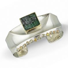 Danielle Miller Jewelry Green Tormaline And Fancy Colored Sapphire - Ridge Cuff Hand forged cuff bracelet in sterling silver, 18k and 14k gold, natural surface green tourmaline and fancy colored princess cut sapphires.