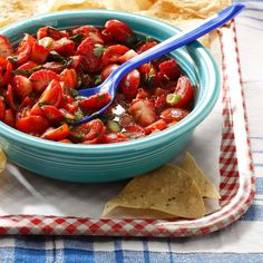 Strawberry Tomato Salsa Recipe -Here's a sweet and tangy salsa that's miles away from the spicy version people expect. Serve it as an appetizer with tortilla chips for scooping, or make it part of the main event and spoon it over white meat. —Amy Hinkle, Topeka, Kansas