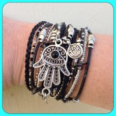 Boho Chic Leather Hamsa Wrap Bracelet with Silver and black accents. by DesignsbyNoa,