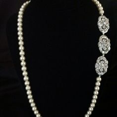 "7371-NL-D  Pearl necklace with three rhinestone pins  21"" length  Reg. price $180.00  Now until Christmas 20% off order now  http://www.victoriarosebridals.com/?product=7371mh"