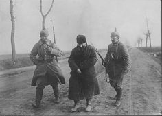 WWI; A captured Russian spy disguised in peasants clothing. -Getty
