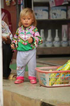 i'm not sure what i'm more in awe of: the fact that this asian baby has a head full of blonde hair or her dope ass beaded jacket...