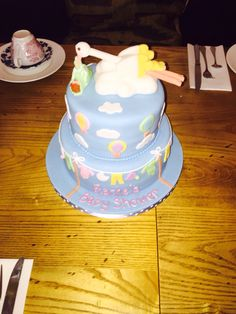 Baby shower stork pastel coloured cake