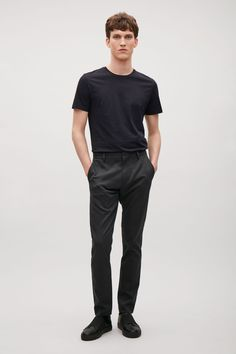 Designed for everyday wear, these flat-front trousers are made from lightly textured cotton twill. A slim-fit style with minimal detailing, they have slanted front pockets, zip-fly fastening and welt pockets on the back.