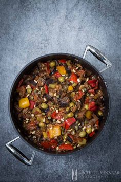 Caponata alla Siciliana is a classic Italian recipe from Sicily. The main ingredients are aubergine, bell peppers, celery, onions, tomatoes, raisins and pine nuts. Everything is slowly stewed and vinegar and sugar are added to give it that classic sweet and sour flavour. Caponata is served as a starter or main course.