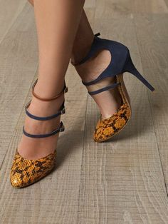 Suede and snakeskin pumps with triple strap.