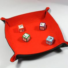 Folding dice tray in burnt orange felt