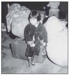 Young Japanese girl on her way to an American internment camp.