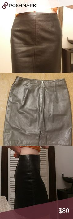 Wilson's Leather Skirt Size eight, slit on the back, high waisted. This is genuine leather, it's really figure flattering. Wilsons Leather Skirts