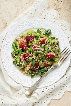 Warm Spring Salad is full of wonderful spring foods - asparagus, peas and strawberries - plus lots of favorites like quinoa, garlic and leeks. Topped with a great homemade dressing.