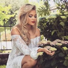 I walk around what little part of the city that wasn't completely destroyed, and look at the flowers. They seemed wilted, so I caress them gently in my palm and watch them grow. I hear something behind me snap, and I whip my head around seeing you with a scared face (Open rp with Gray)