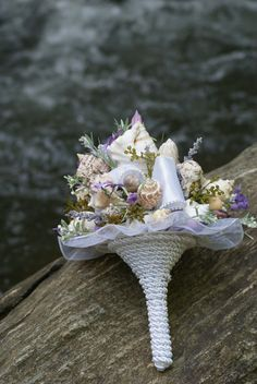 Purple, Ribbon, and Seashell Bouquet / Beach Bouquet. $95.00, via Etsy.