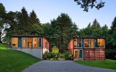 12 Homes Made From Shipping Containers: This Adam Kalkin Container House in Califon, New Jersey, is three shipping containers wide by two shipping containers tall. Glass on two sides allows ample light to shine in, and the industrial materials continue throughout, with a concrete floor and steel beams and columns.