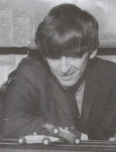 George Harrison (George definitely was a car lover. Here he is with some toy ones. Beatles Love, John Lennon Beatles, Just Good Friends, Best Friends For Life, What Makes You Beautiful, Beautiful Men, The Quarrymen, What Is My Life, Queen Photos