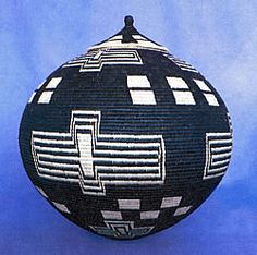 Africa | Basket by Zulu master weaver Beauty Ngxongo. ca. 1991, South Africa. | Beauty is well known for her 'isichumo' baskets, a water tight vessel.