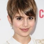 Pixie haircut with long side bangs