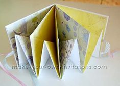 """square around mini album tutorial,  you may have seen it around as a room mini album. It is a cute little mini book that you can display on around your home. Materials:   Four 12""""x12"""" Scrapbook card papers;  Two 6 1/8"""" chipboard or cardboard for the covers;  Scrapbooking embellishments;  Scissors or craft knife, pencil, adhesive - glue or double sided tape;  two lengths of ribbon approx 12"""" long"""