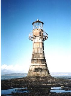 Whitford_Lighthouse - this beautiful tapered cast iron lightouse constructed in 1865 is endangered, and nearing collapse. the range and beauty in the design of lighthouse structures all over the world is captivating – it would be more than a lifetime's journey to go there.