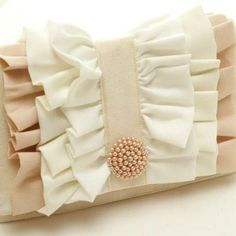 Ruffled Clutch Tutorial/ Wonder how this would look as a pillow...chairback cover ??