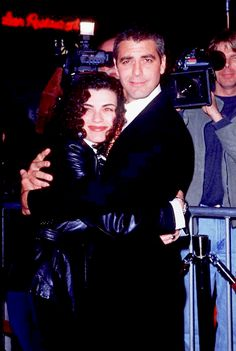 Julianna Margulies & George Clooney (were on ER together). ER was a good show.