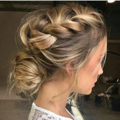 Side crown braid in a messy bun hairstyle