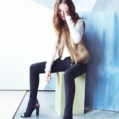 A faux fur vest and a trendy heel can take the jeans and t-shirt look to a whole new level.