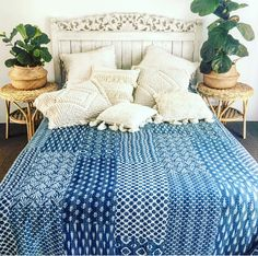Hand stitched bed cover mixed with boho cushions ..