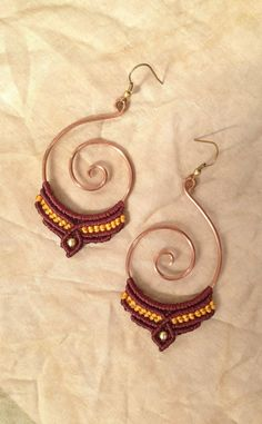 This beautiful tribal style macrame earrings made from copper wire spiral.  The material of the macrame is waxed waterproof string - you can wash with water  The earrings is available in every color.  Thank you for visiting my shop