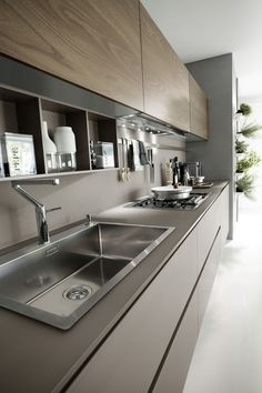 "System Collection is a modern kitchen that is easy and only creates light barriers between the living areas. This model distinguishes itself by coupling technology with natural materials while the visible structures support, organize and contain, the worktop extends like a real working surface. This while the geometric shapes, with essential lines and generous dimensions, create a refined and contemporary ""oasis"", with a trenchant and luxury personality, dedicated to living in the kitchen."