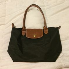 SMALL LONGCHAMP TOTE NO RIPS OR TEARS!! Unfortunately I don't have the measurements for this bag but it's the smaller of Longchamp's totes. I'm also not sure if it's real or not so if there's any way of verifying that - Let me know and I'll take a picture! Feel free to make me a reasonable offer or ask me any questions (: Longchamp Bags Totes
