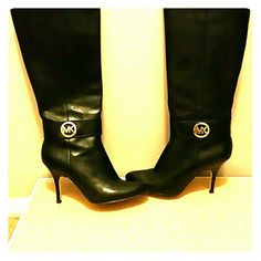 Michael Kors Caroline Boots Black boots with the MK logo on the side of each one. The boots hit a couple of inches below the knee. 14inch calf circumference...3.5 inch heel....worn twice MICHAEL Michael Kors Shoes Heeled Boots