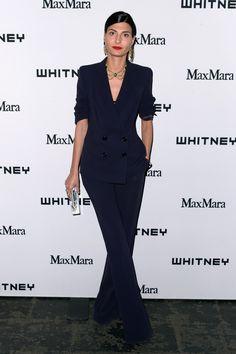 Soft Dramatic: Giovanna Battaglia | NOTE: Adding ornate drama to a softly-tailored classic suit.