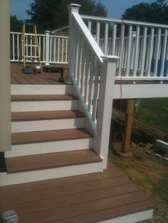 Deck rebuilt in Fairfield County Connecticut with Trex decking and vinyl railings. Wrapped in PVC trim.  By Guilford, CT deck builder Craftsman Remodeling