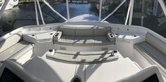 Hatteras GT The seating surrounding the helm is all about socializing. The covered compartments are refrigerated storage. Hatteras Yachts, Yacht Interior, Palm Beach, Convertible, Boat, Interiors, Storage, Purse Storage, Infinity Dress
