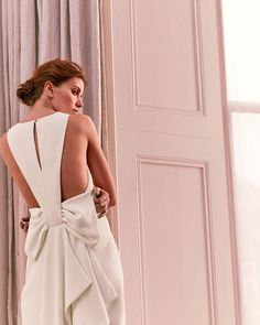 DELILLY Waterfall back column Wedding dress. Elegantly understated from the front and making a big statement at the back, DELILLY is the dress you've been searching for to celebrate your big day. This clean-lined design cascades to the floor in a flattering column shape and shows off the smooth curves of your back to ultra-feminine effect.{affiliate link} #weddingdress #bridalgown #weddinggown #wedding