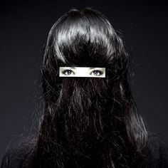 Swedish designers Humans since 1982 have created a hair clip with eyes on to make the wearer look like they're standing the other way round and wearing a niqāb headdress