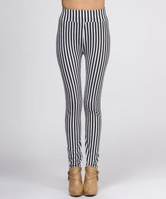 Take a look at this Black & White Vertical Stripe Leggings by BOLD & BEAUTIFUL on #zulily today!